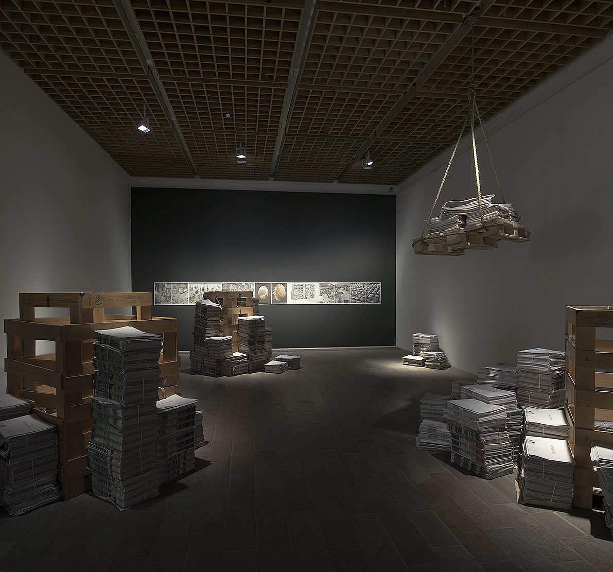 Inventory, Installation with 4000 printed broadsheet newspapers consisting of text, archive images, photographs, forensic documentation, newspaper quotes and musical score.