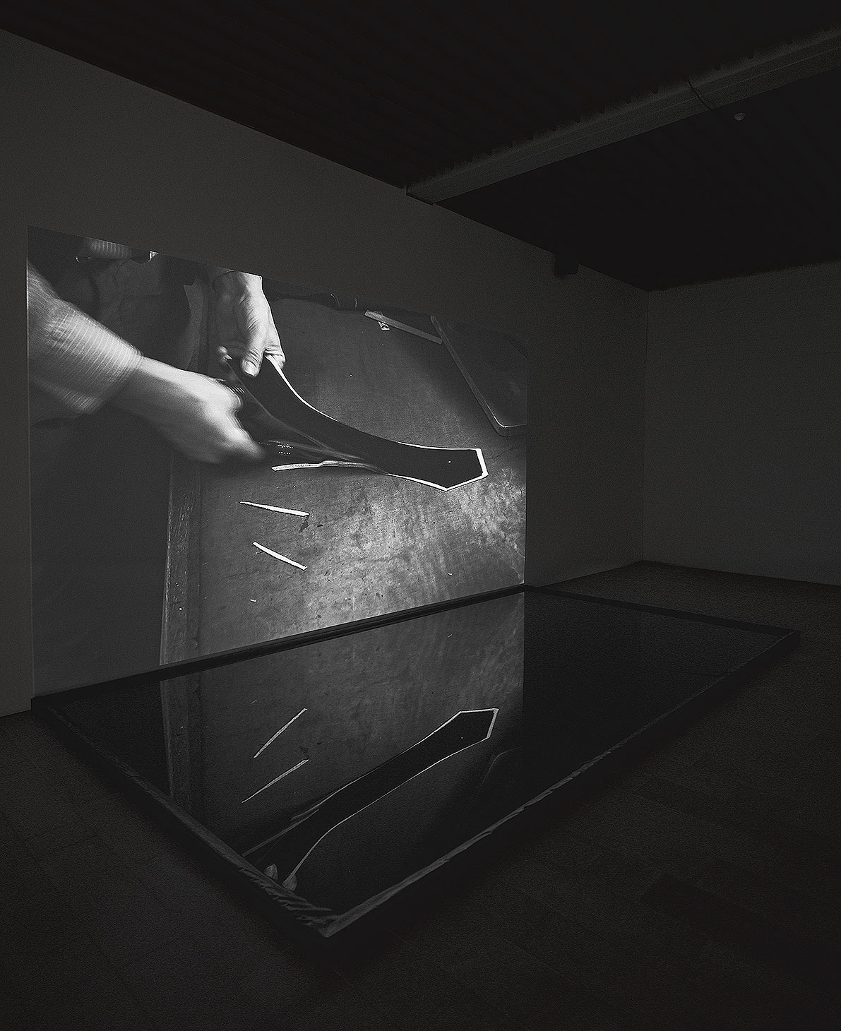 Tailor, video-installation: projection, Foley-sound, water pool.