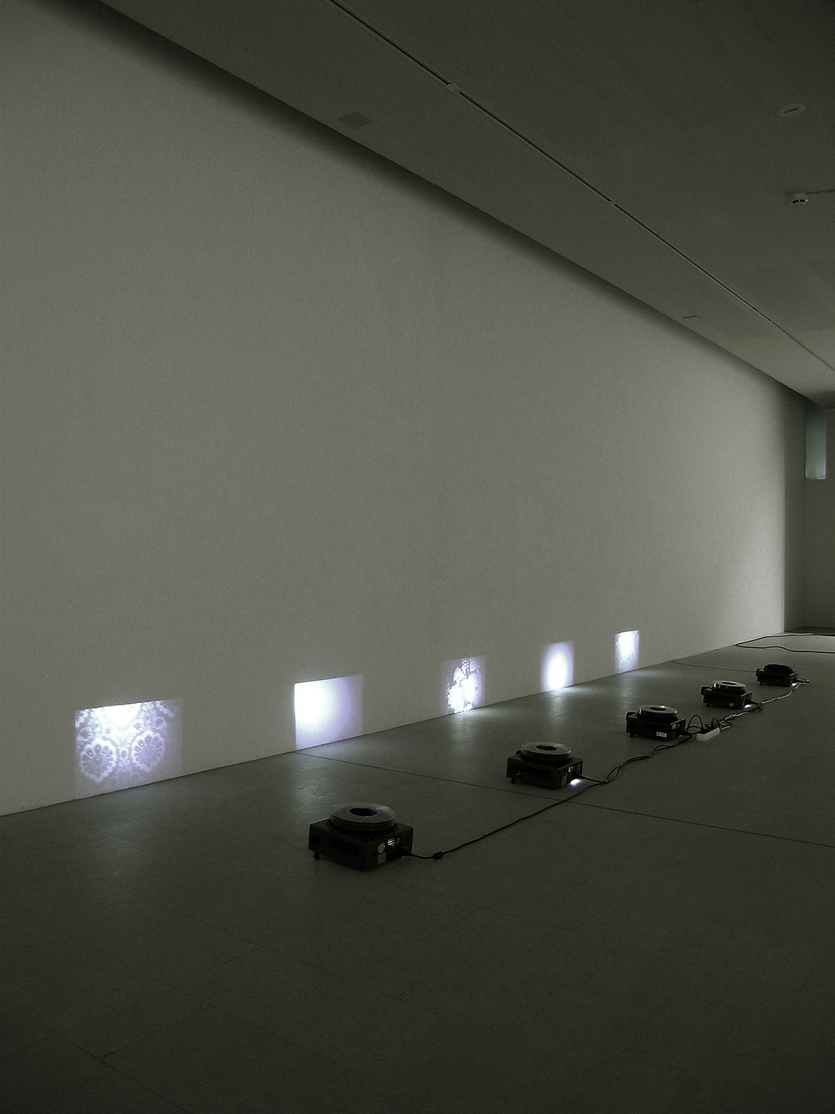 Visitor, 5 slide projections, size of each projection: 30 x 45 cm (during the exhibitions the lamps of the projectors burned away the pigment of the slides.)