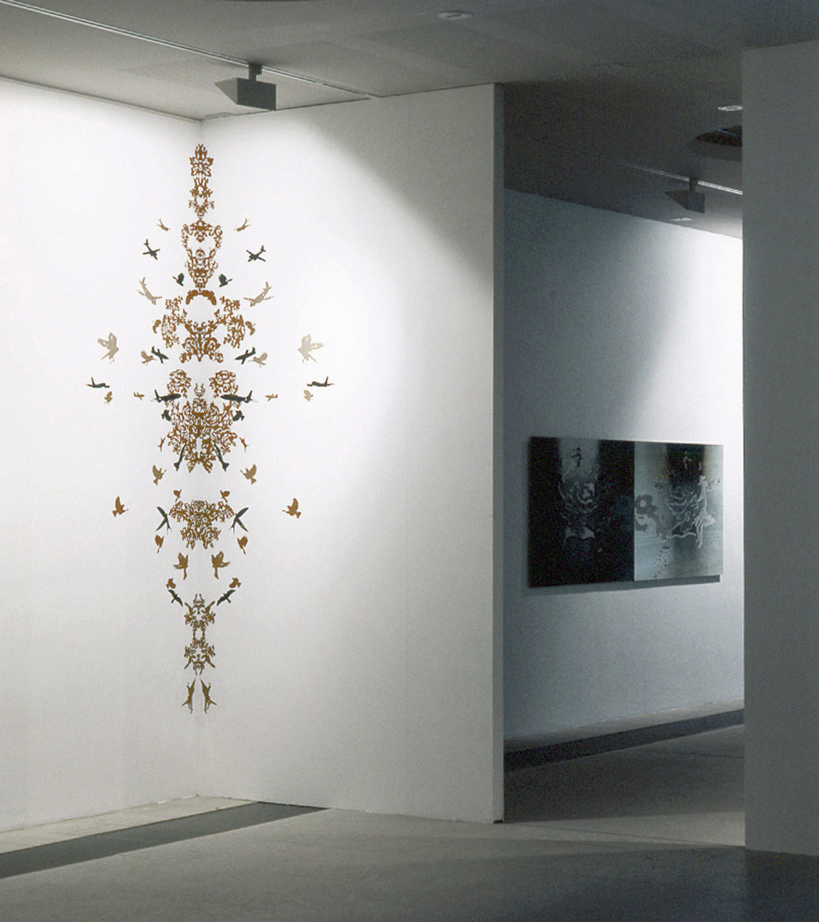 Installation view of the exhibition, Mnemonic II, hand cut sticker ornament on wall, size: 250 x 70, Replica I, c-print, size: 90 x 260 cm